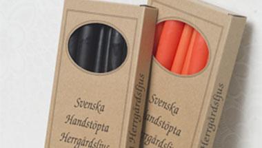 Handstöpta Herrgårdsljus i orange och svart för Halloween
